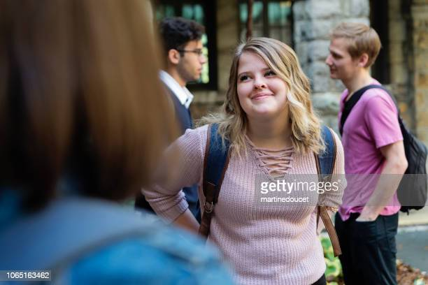 "small group of students chatting at college university entrance. - ""martine doucet"" or martinedoucet stock pictures, royalty-free photos & images"