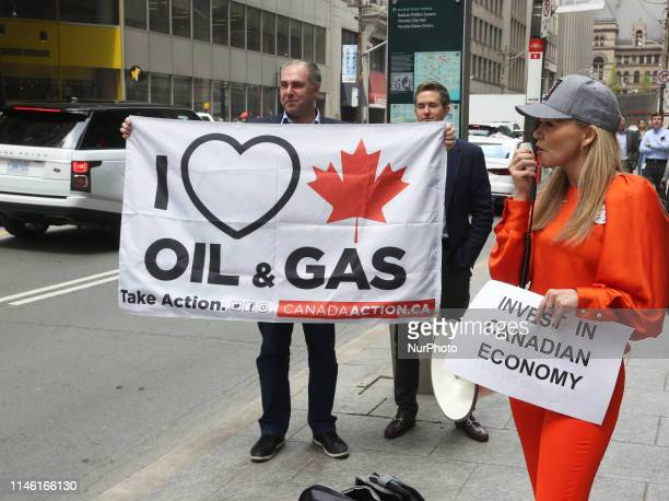 Small group of supporters of the Canadian oil companies rallied to protest against environmental groups protesting against fossil fuels and climate...