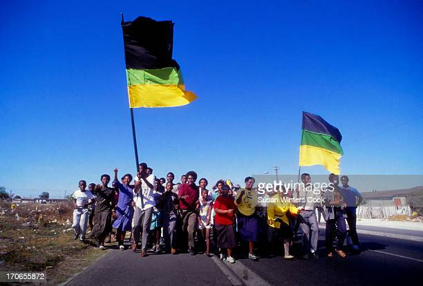A small group of township residents celebrate the release of Nelson Mandela from prison South Africa February 1990