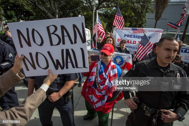 A small group of Trump supporters confronts marchers during the Immigrants Make America Great March to protest actions being taken by the Trump...