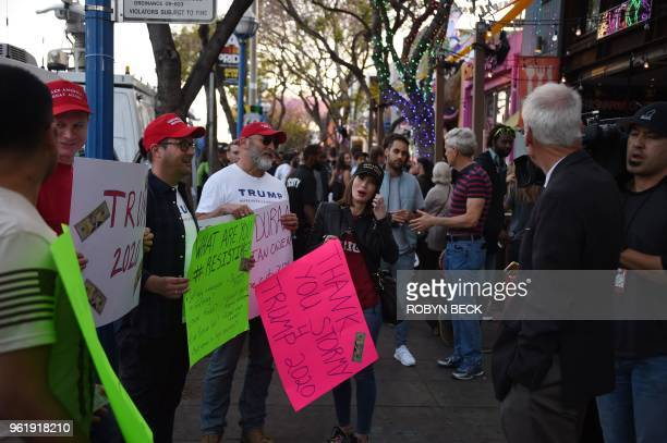 A small group of Trump supporters talk to passers by and members of the media near Chi Chi Larue's adult entertainment store in West Hollywood...
