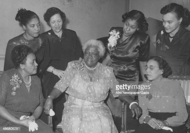 Small group of women from North Carolina, including civil rights leader Mary McLeod Bethune, in attendance at a meeting of the African American...