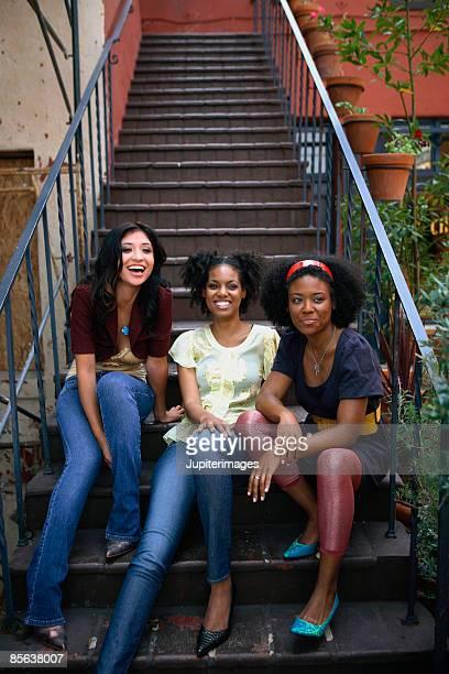 small group of women sitting on stairs - twickenham stoop stadium - fotografias e filmes do acervo