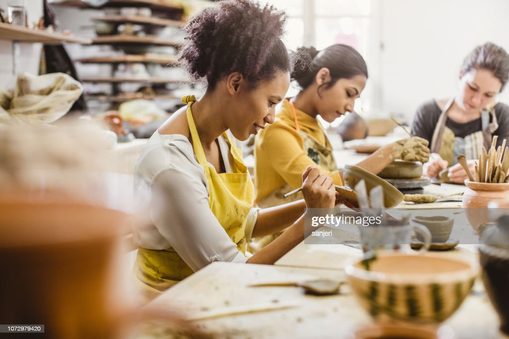 Small Group of Young People Creating Pottery : Stock Photo