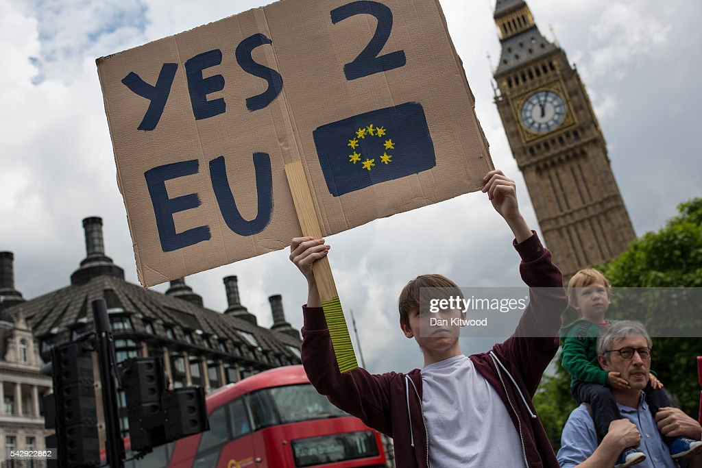A small group of young people gather to protest on Parliament Square the day after a majority of the British public voted for leaving the European Union on June 25, 2016 in London, England. The ramifications of the historic referendum yesterday that saw the United Kingdom vote to Leave the European Union are still being fully understood. The Labour leader, Jeremy Corbyn, who is under pressure from within his party to resign has blamed the 'Brexit' vote on 'powerlessness', 'austerity' and peoples fears over the issue of immigration.