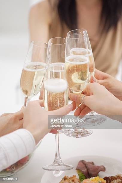 Small group of young women toasting with glasses of champagne