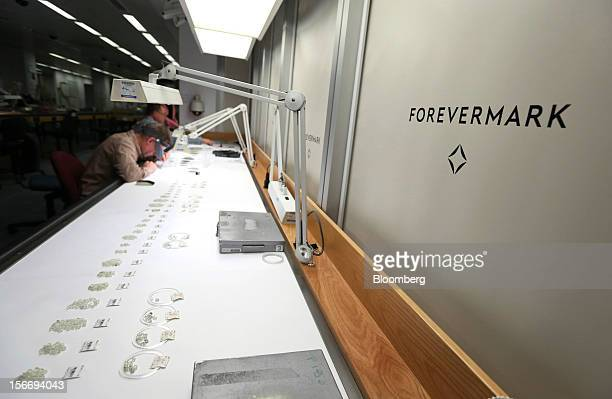 Small groups of uncut diamonds arranged into different grades are seen on the sorting table at the De Beers office in London UK on Friday Nov 16 2012...