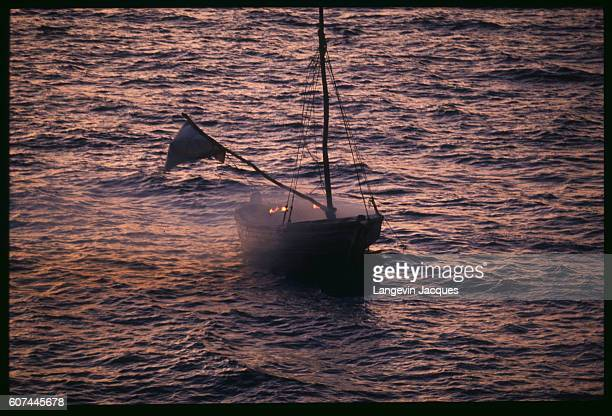 A small Haitian refugee boat flies a white flag of peace as it travels the Atlantic Ocean toward the United States US President Bill Clinton offered...