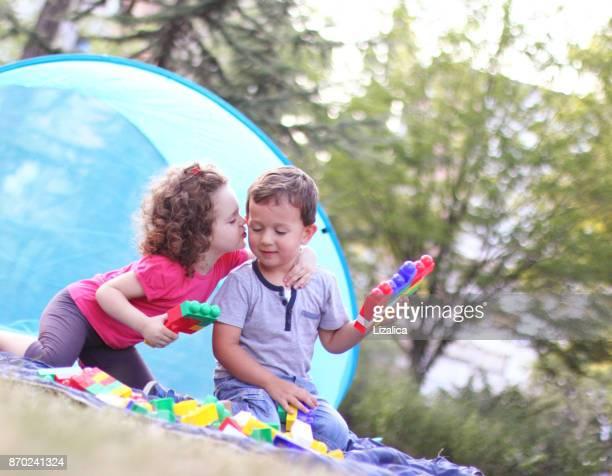 Small happy kids having fun in nature