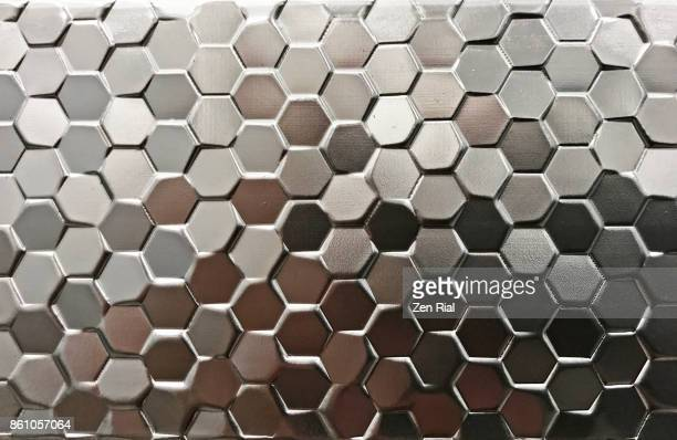 Small hexagonal tiles on a decorative frame
