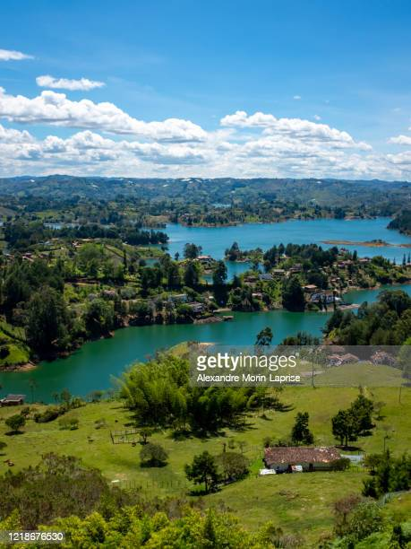 small hills surround by the water that look like islands near to guatape peñol - guatapé stock pictures, royalty-free photos & images