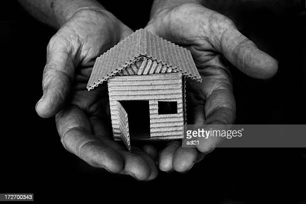 a small house built out of cardboard being held - domestic violence stock pictures, royalty-free photos & images