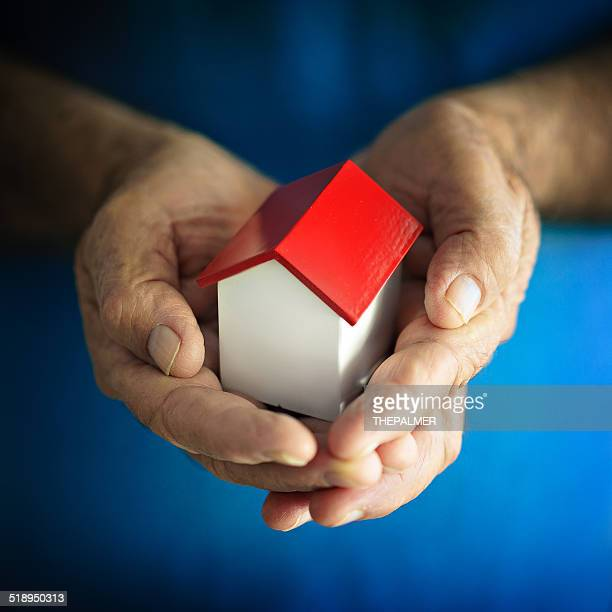 Small house hold by a senior man
