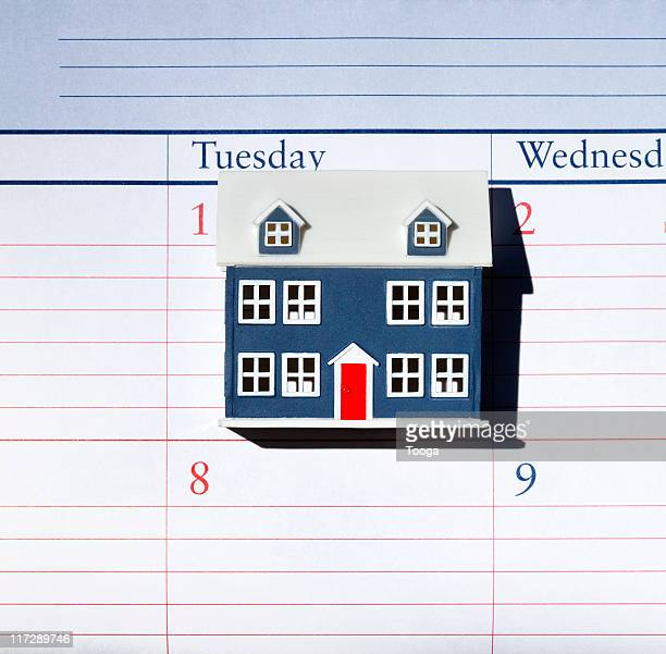 small house sitting on calendar - monthly event stock pictures, royalty-free photos & images
