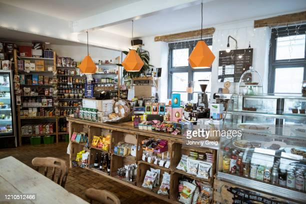 small independent vegetarian health food shop and vegan cafe - health food shop stock pictures, royalty-free photos & images