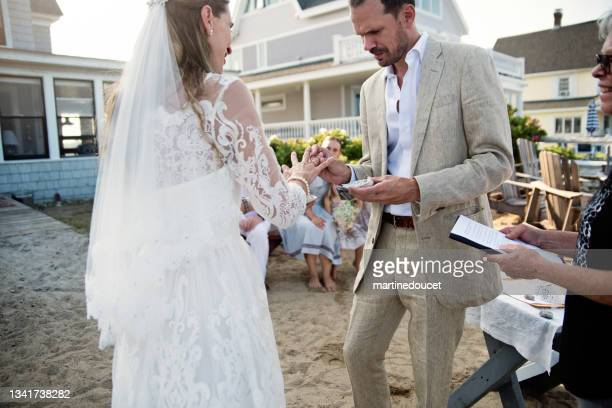 """small intimate wedding ceremony in family beach house. - """"martine doucet"""" or martinedoucet stock pictures, royalty-free photos & images"""