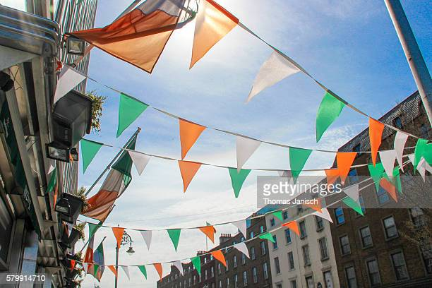 small irish colored flags crossing the street, dublin, ireland - irish flag stock pictures, royalty-free photos & images