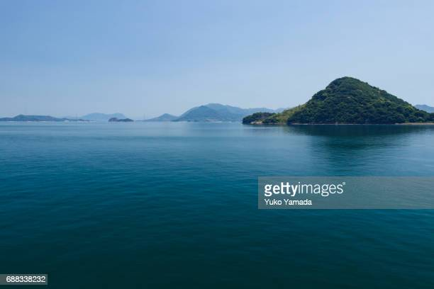 Small Island Calm Sea Over Blue Sky, Hiroshima, Japan