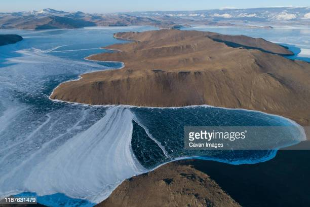 small island ice sorrounded from aerial view - continental_shelf stock pictures, royalty-free photos & images