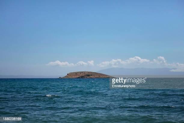 a small island near the coast at gümüldür,aegean turkey. - emreturanphoto stock pictures, royalty-free photos & images