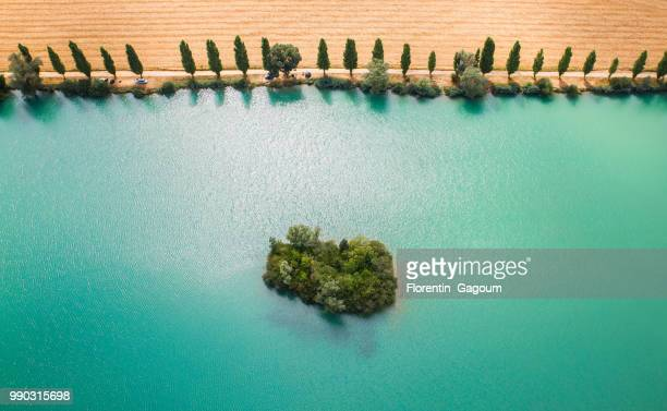 Small island on green lake