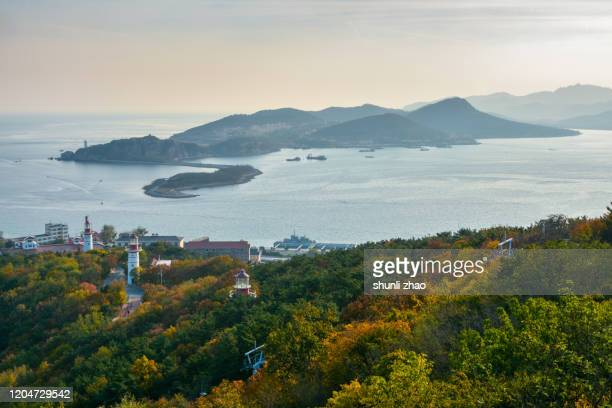 a small island on the sea - liaoning province stock pictures, royalty-free photos & images