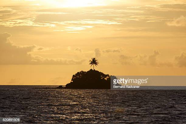 Small island silhouetted at sunset, Palau, Cocos Island National Park, Puntarenas Province, Costa Rica
