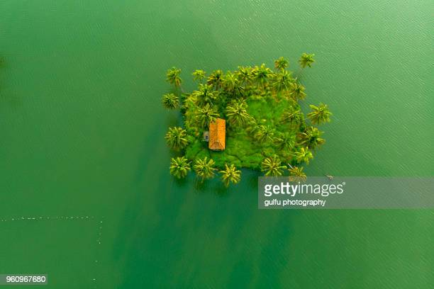 small islands with buildings - island stock pictures, royalty-free photos & images