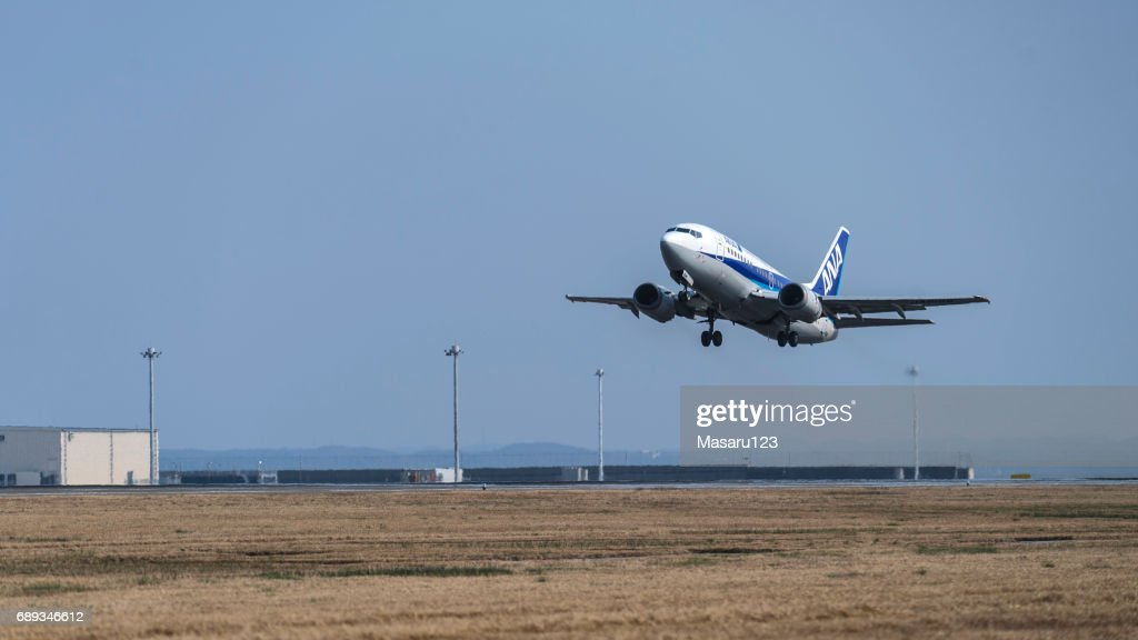 Small jet approaching to a runway : Stock Photo