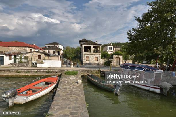 a small jetty at ioannina lake's(pamvotis) island - epirus greece stock pictures, royalty-free photos & images
