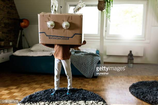 small kid pretending to be a robot at home. - cardboard box stock pictures, royalty-free photos & images