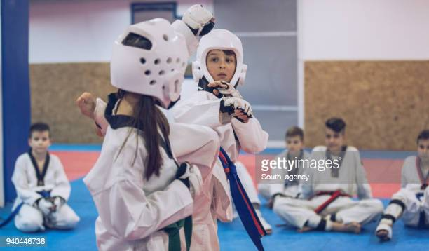 Small kids training taekwondo