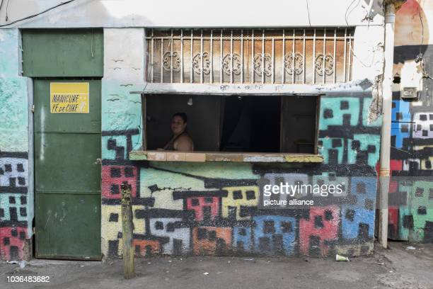 Small kiosk on Rua 2 with wall paints by peacs activist Marieluce in the favela Complexo do Alemão in Rio de Janeiro, Brazil, 16 July 2016. The...