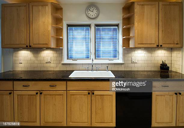 Small kitchen space with two small windows