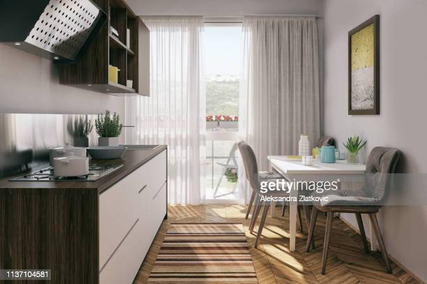 small kitchen with dining table - household equipment stock pictures, royalty-free photos & images