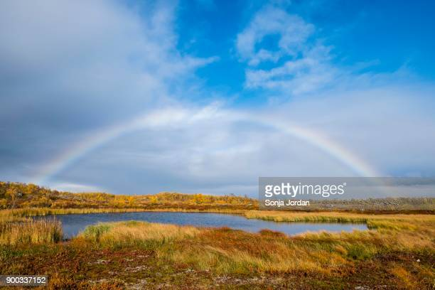 small lake in autumnal landscape with rainbow, norrbottens, norrbottens laen, laponia, lapland, sweden - swedish lapland stock photos and pictures
