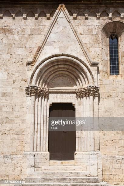 Small lateral portal,Collegiata or Pieve di Osenna, San Quirico d' Orcia, Tuscany, Italy, Europe.
