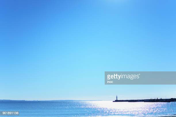 small lighthouse under clear blue sky - 空 ストックフォトと画像