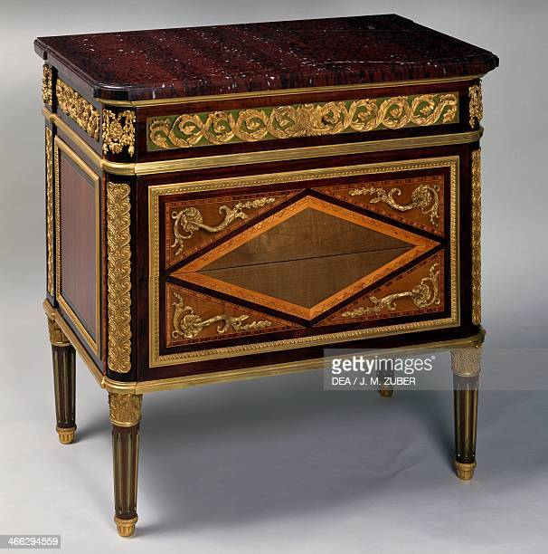 Small Louis XVI style Second Empire commode with rosewood lemonwood amaranth and green painted lime wood inlays gilt and chiselled bronze decoration...