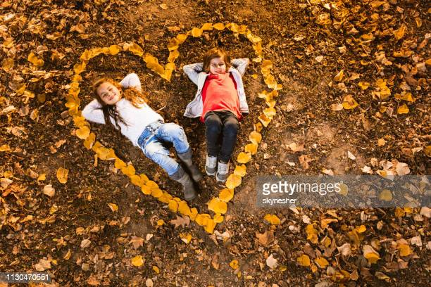 small love in autumn leaves! - innocence stock pictures, royalty-free photos & images