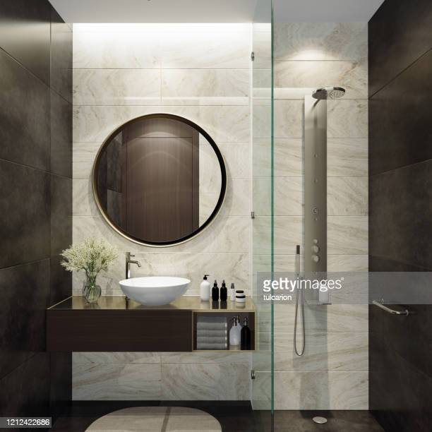 small luxurious minimalist bathroom with round mirror - lavandino foto e immagini stock