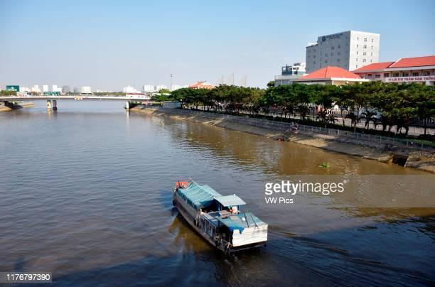 Small market boat in the Saigon river Ho Chi Minh City Vietnam