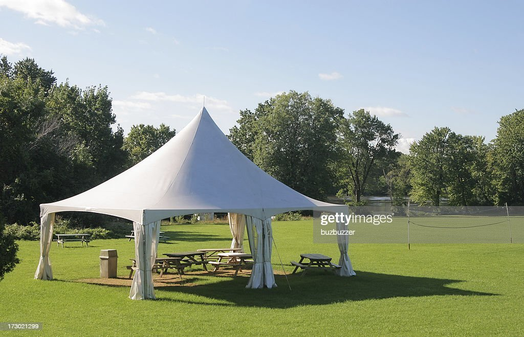 Small Marquee Tent with picnic tables in a park : Stock Photo
