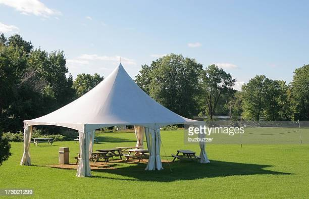 Small Marquee Tent with picnic tables in a park