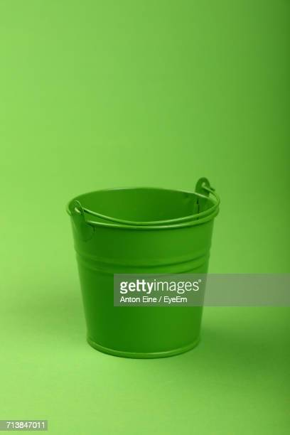 Small Metal Bucket On Green Background