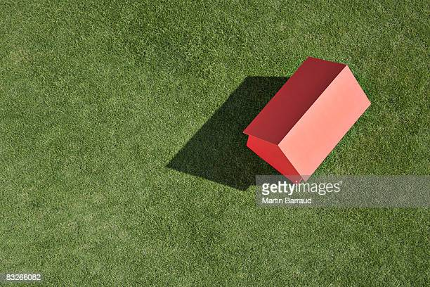 small model house on grass - layoff stock photos and pictures
