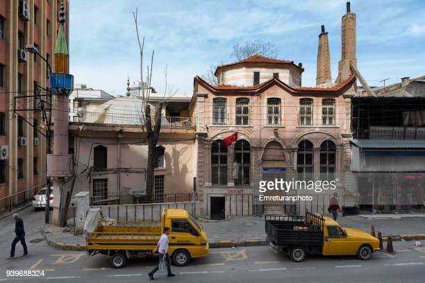 small mosque and turkish bath and parked pickup trucks on a street in izmir. - emreturanphoto stock pictures, royalty-free photos & images