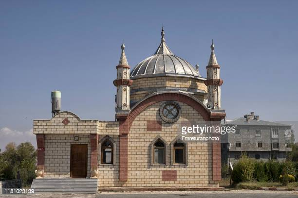 small mosque in a petrol station,van lake. - emreturanphoto stock pictures, royalty-free photos & images