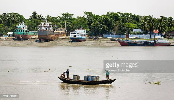 A small motorboat rides through the port of Khulna on April 11 2016 in Khulna Bangladesh