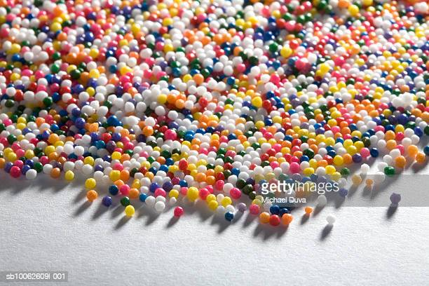 Small multi colored balls on floor, close-up
